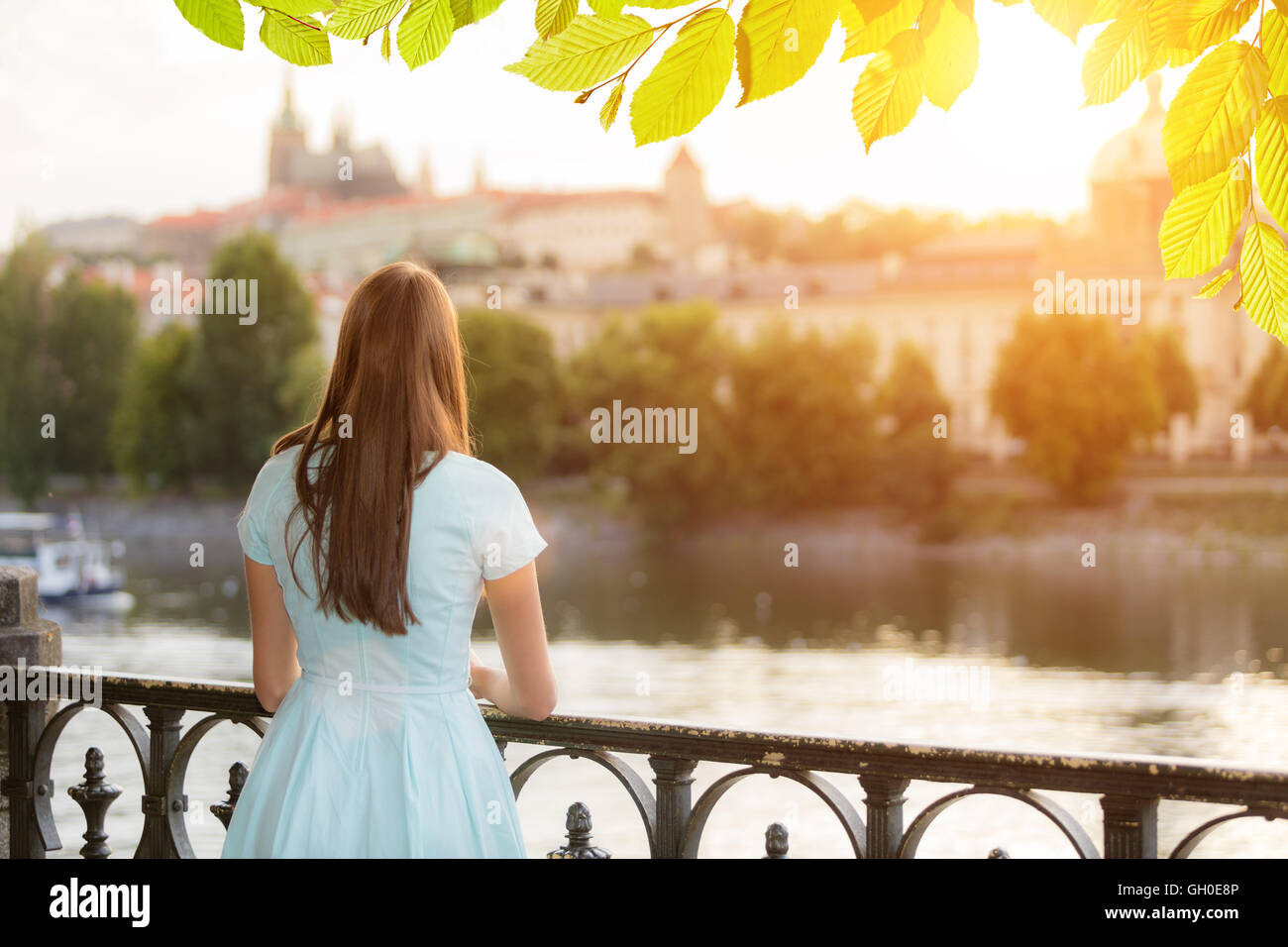 Backside of brunette girl watching old town center in Prague, Czech republic, Europe - Stock Image