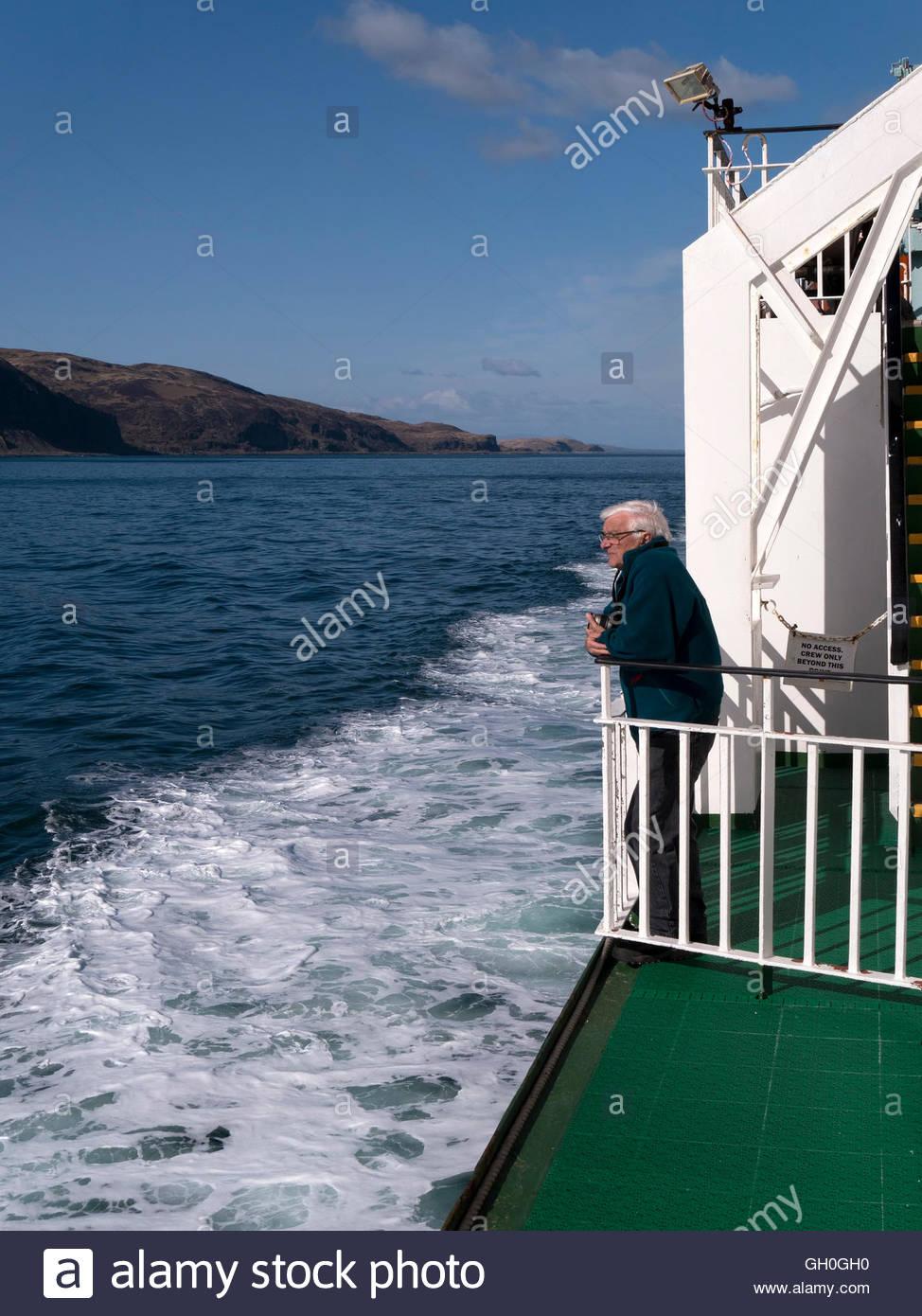 Passenger admires view from Caledonian Macbrayne ferry (Clansman) in Sound of Kerrera, Oban, Scotland, UK. - Stock Image
