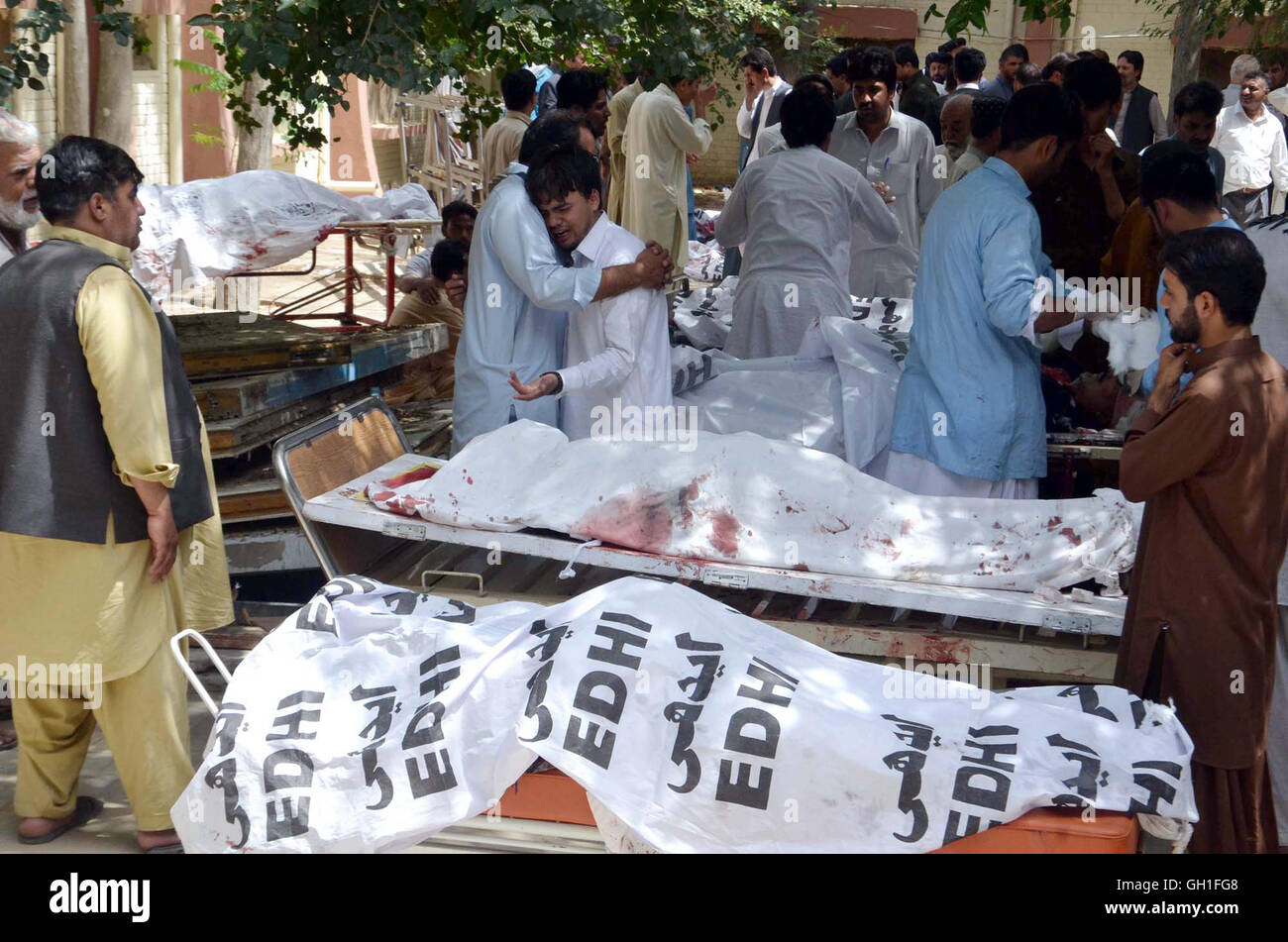 People gather near dead bodies of bomb blast victims that occurred ...