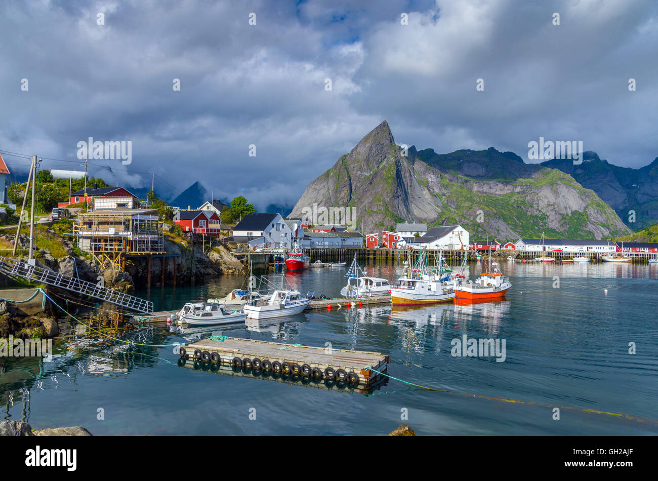 Reine, Lofoten Islands with sea and surrounding mountains - Stock Image