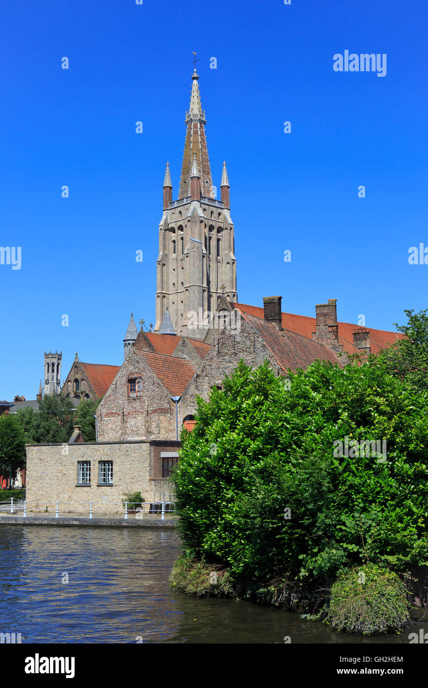 The Old Saint John's Hospital (11th century) and the Church of Our Lady (13th-15th centuries) in Bruges, Belgium - Stock Image