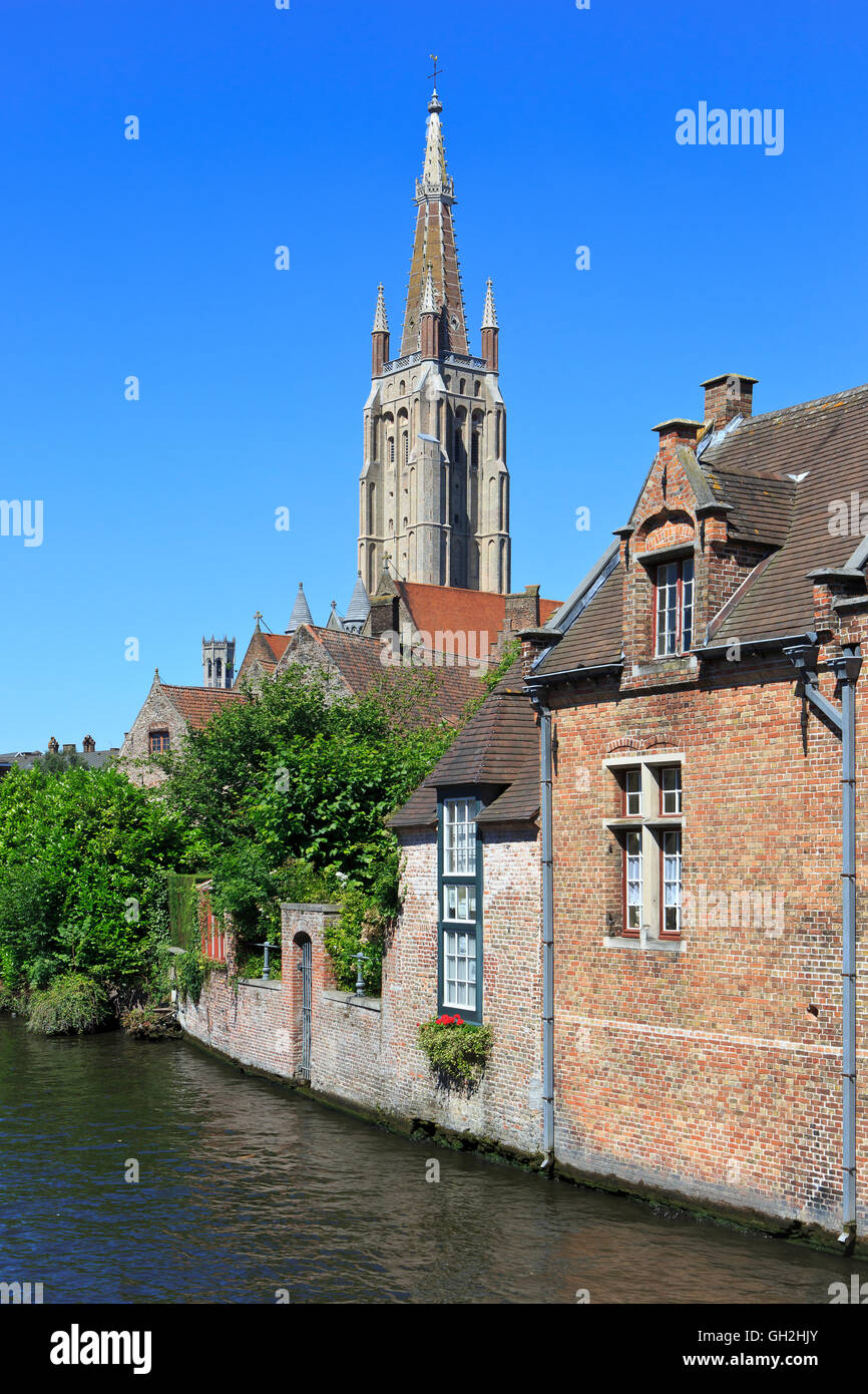 Canal leading to the Old Saint John's Hospital and the Church of Our Lady in Bruges, Belgium - Stock Image