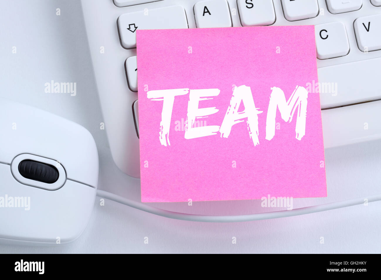 Team teamwork working together business concept office computer keyboard - Stock Image