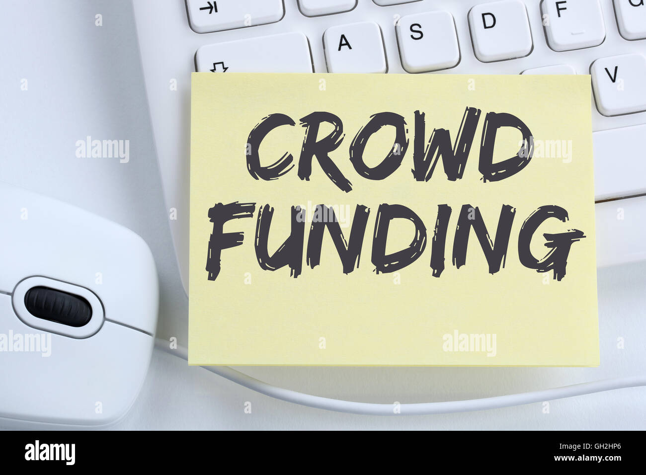 Crowd funding crowdfunding collecting money online investment internet business concept office computer keyboard - Stock Image