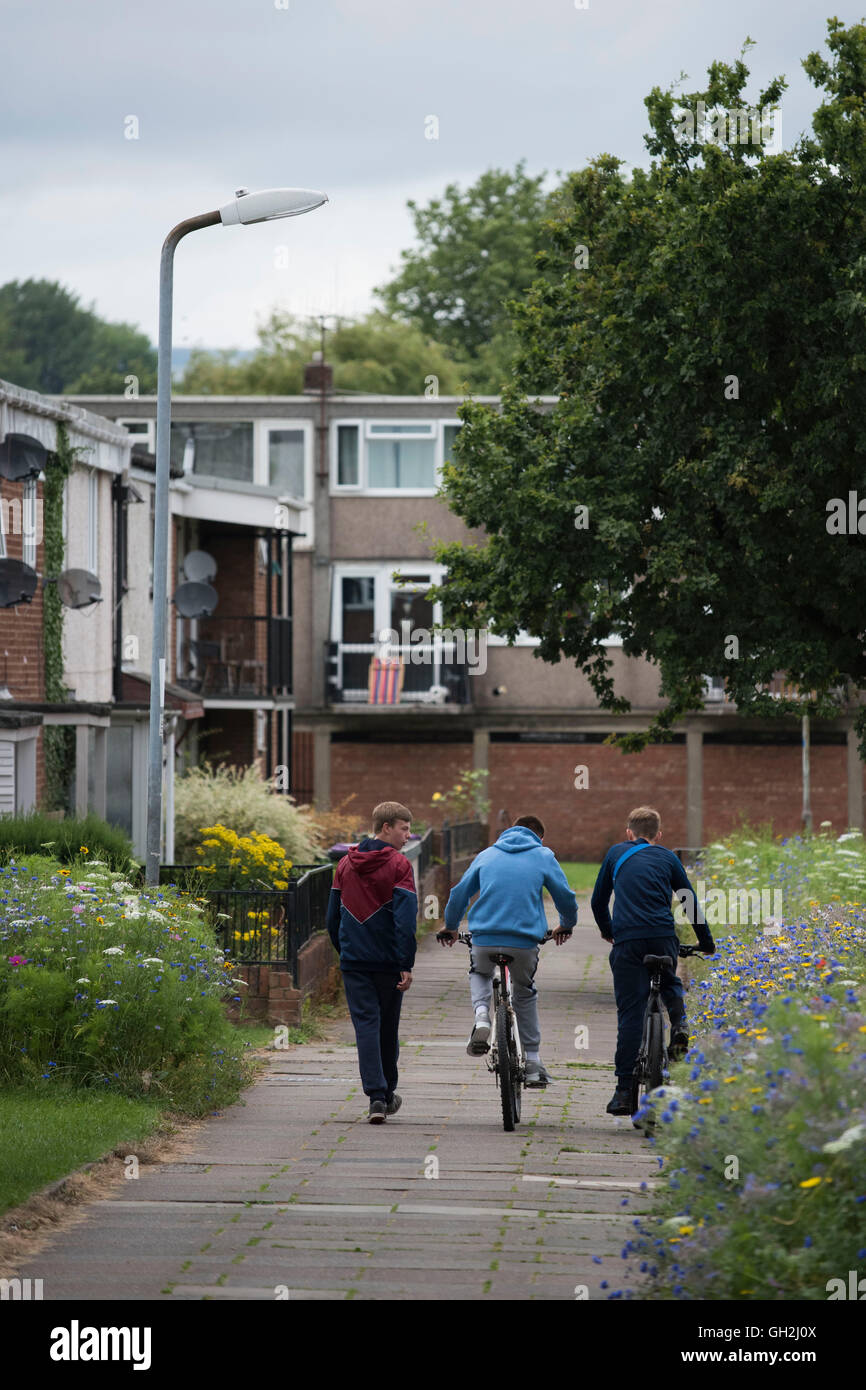 Youths teenagers ride bikes on a council estate in Cwmbran, Newport, Wales. - Stock Image