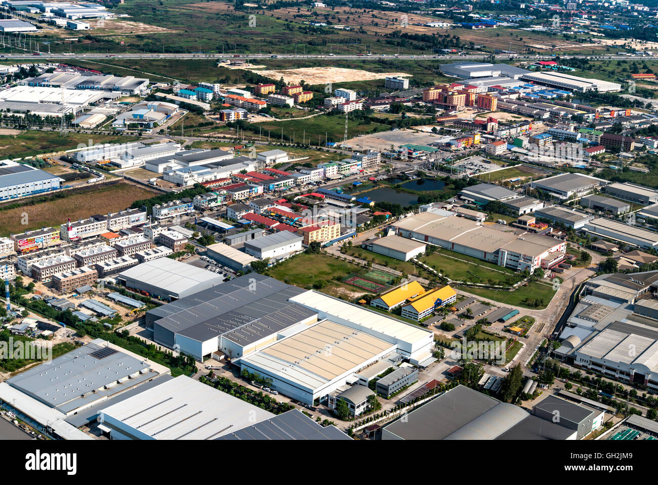 Industrial estate factories manufacture and housing projects - Stock Image