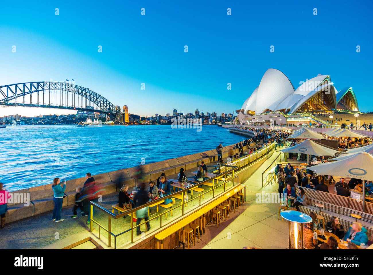 People dining at outdoor restaurants in Circular Quay in Sydney, Australia - Stock Image