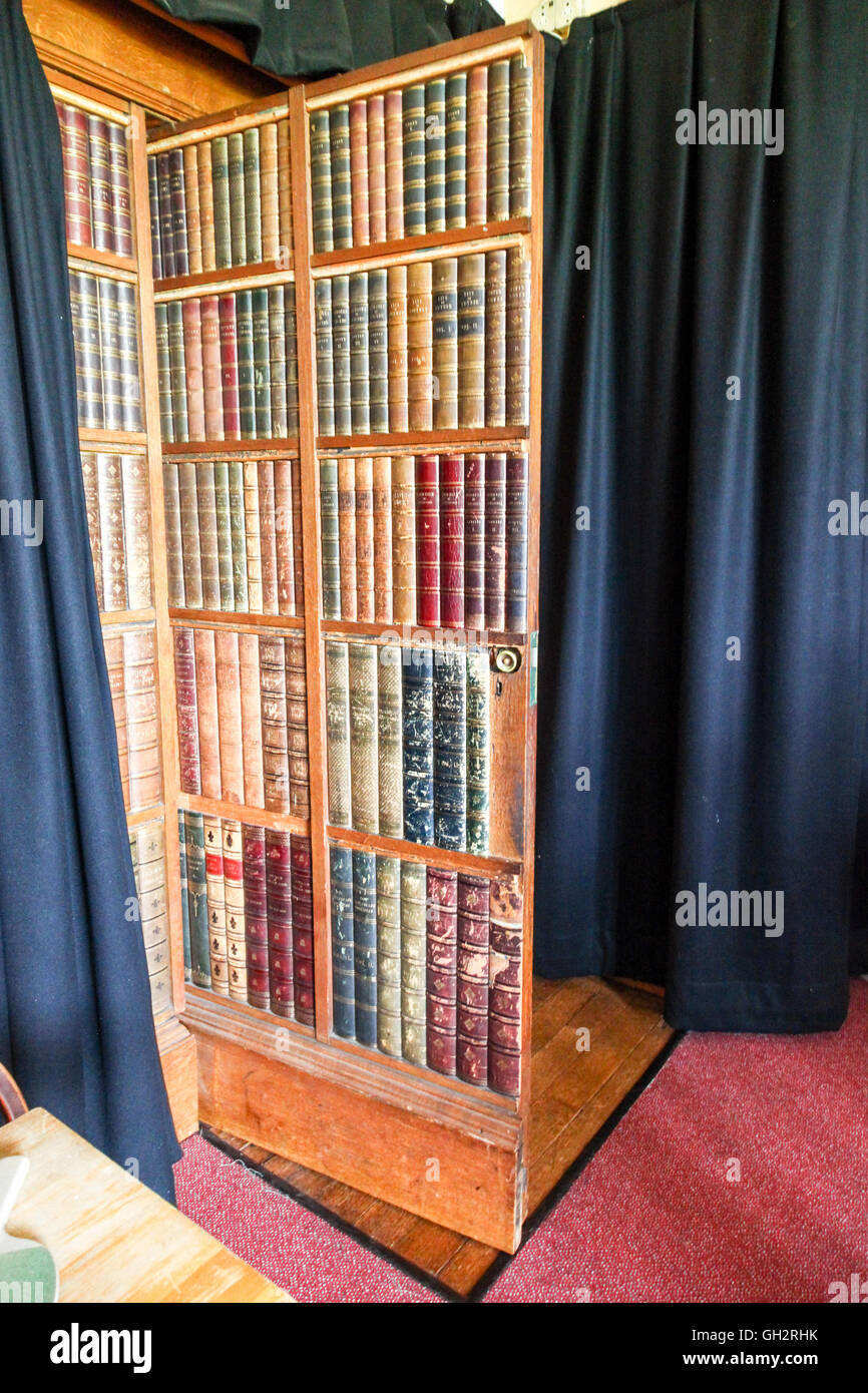 A door made to look like book shelves at Ingestre Hall Ingestre Staffordshire England UK - Stock Image