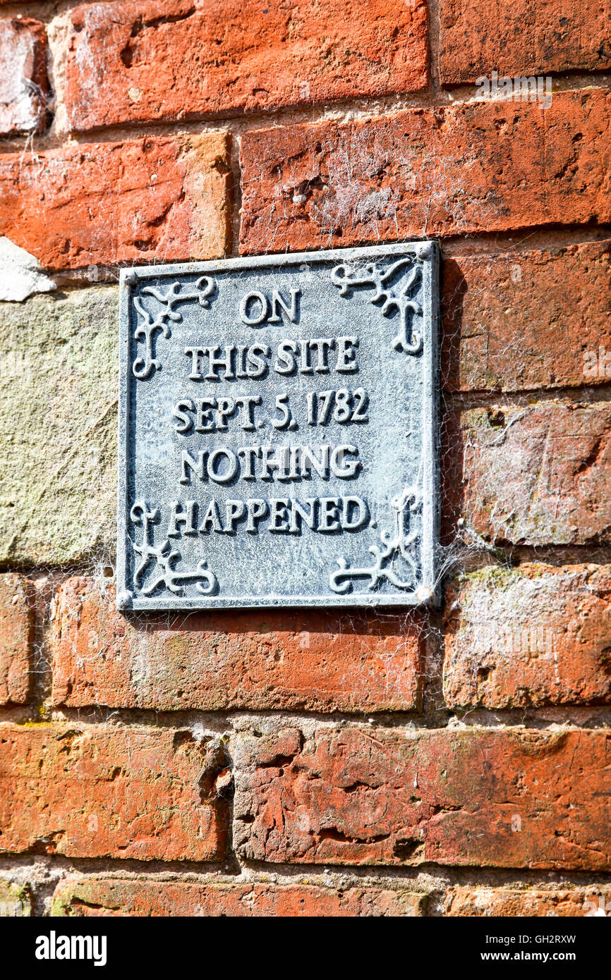 A sign on a wall saying On this site September 5th 1782 nothing happened - Stock Image