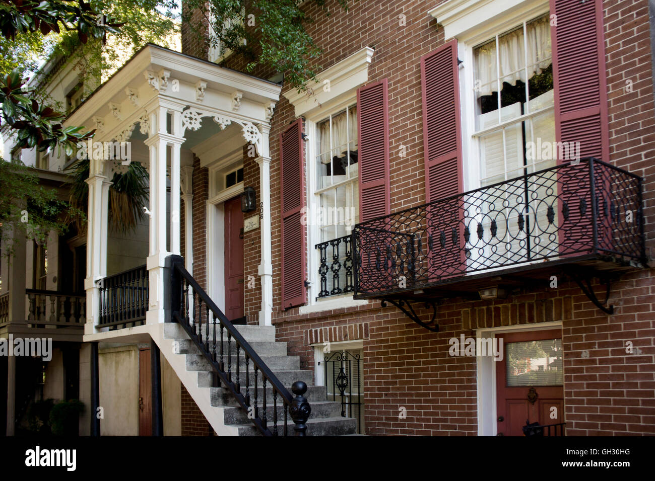 1869 Federal-style home with ironwork and hurricane shutters.  Savannah, Georgia. - Stock Image