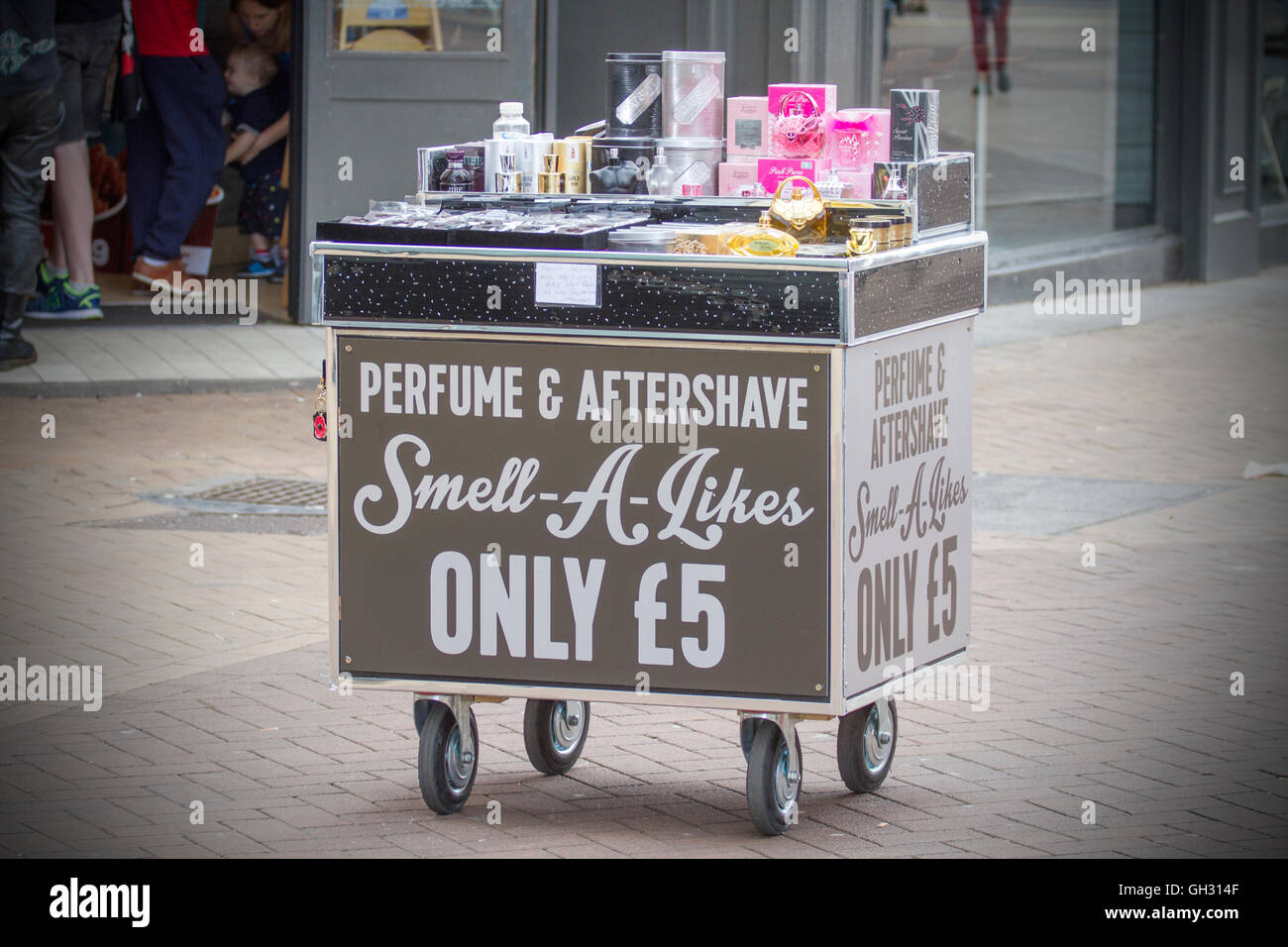 Trolley selling Mobile Perfume and Aftershave Smell-a-likes only £5 - Stock Image