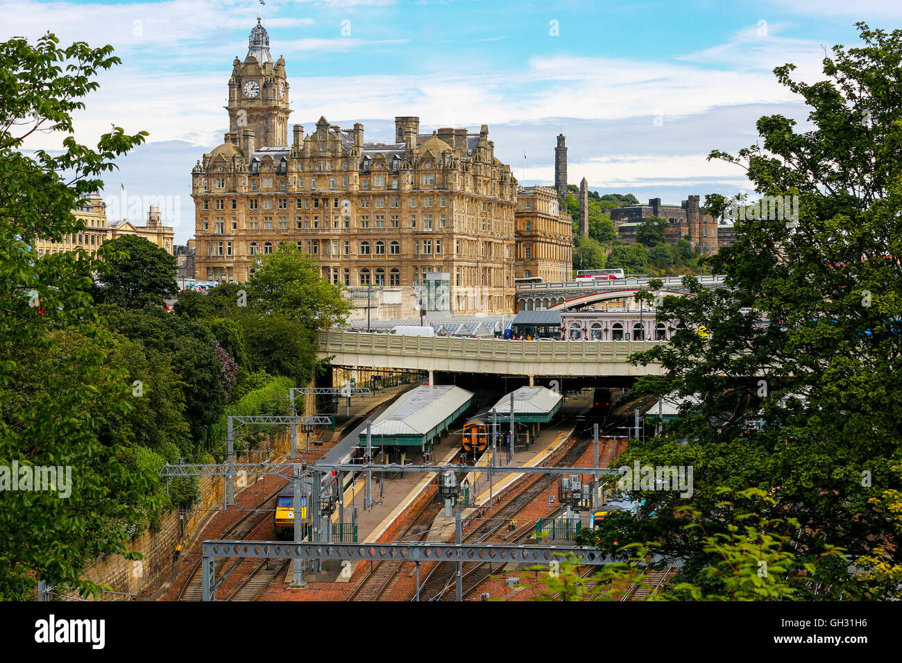 Waverley railway station and the Balmoral Hotel on Princes Street, Edinburgh, Scotland, UK - Stock Image