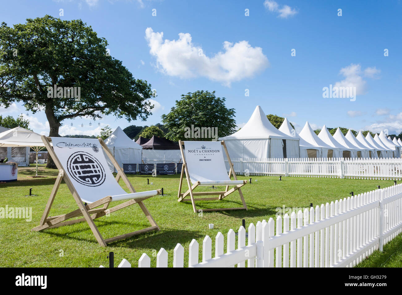 Giant deck chairs outside Corporate Hospitality tentage at Henley-on-Thames regatta, Oxfordshire, England, GB, UK. - Stock Image