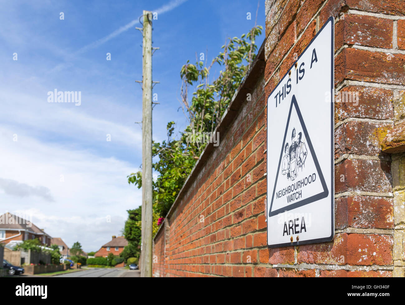 Neighbourhood Watch sign on a small road in the UK. - Stock Image