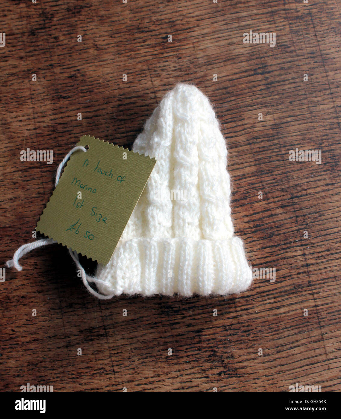 A baby's hat hand knitted from a yarn with a touch of merino wool in the mix. - Stock Image