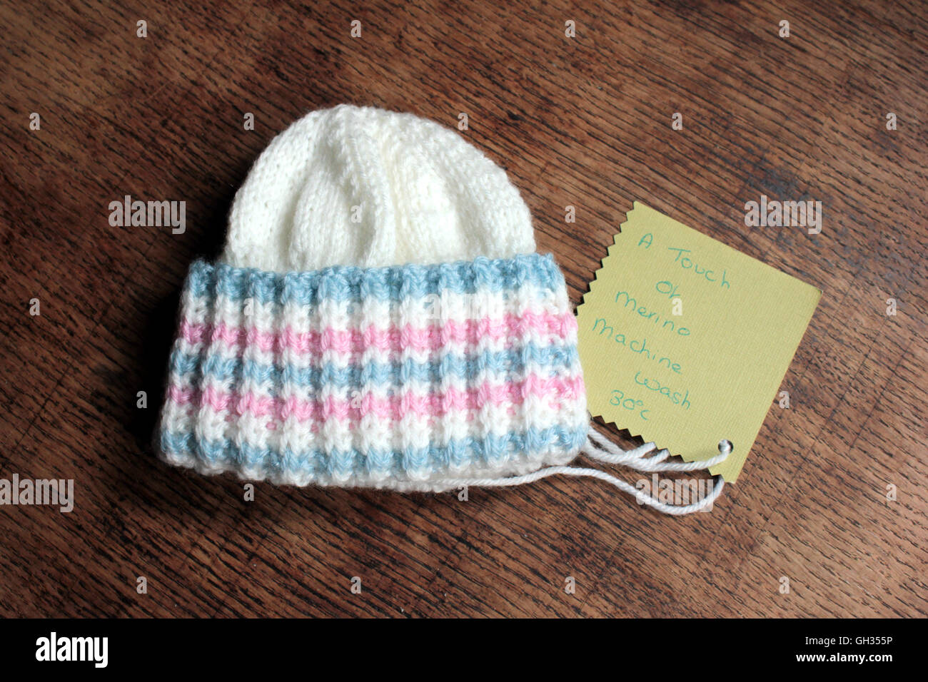 A baby's hat hand knitted from a yarn with a touch of merino wool in the mix - Stock Image