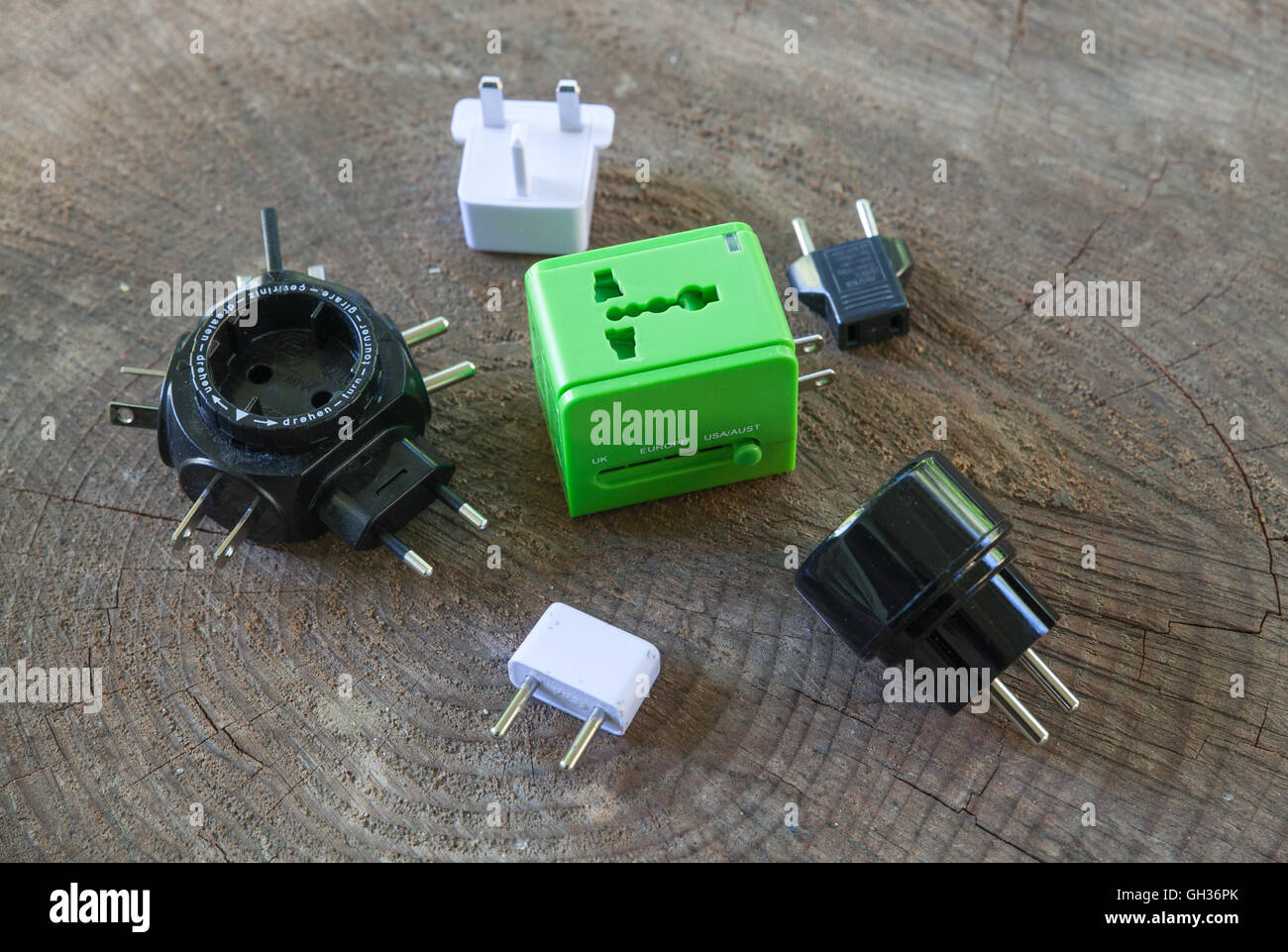A traveler's collection of international adapter plugs - Stock Image