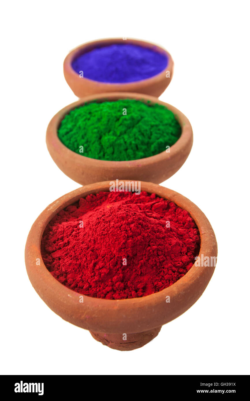 Various colored dyes in earthen bowls isolated on white. - Stock Image