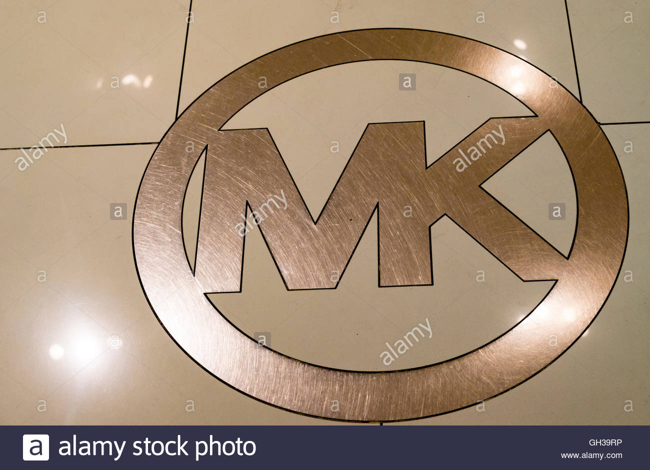 Michael Kors brand logo engraved outside the store's wall. Michael Kors is a New York City-based American sportswear - Stock Image