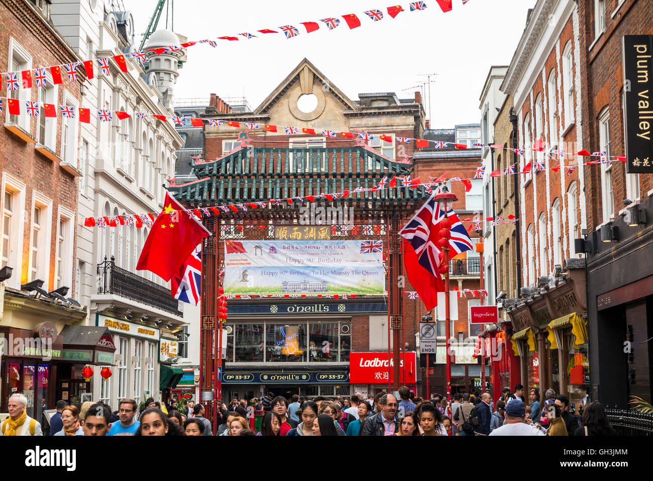 Street scene in Chinatown, West End (Westminster), London, UK with O'Neill's pub in the background - Stock Image