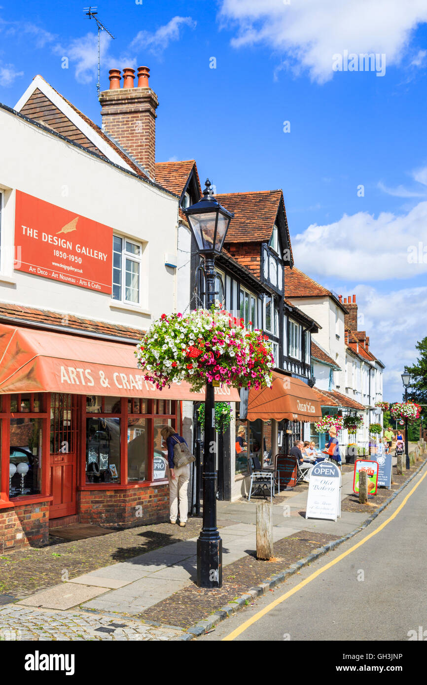 Street scene with shops at Westerham, a town in the Sevenoaks District, Kent, in summer on a sunny day - Stock Image