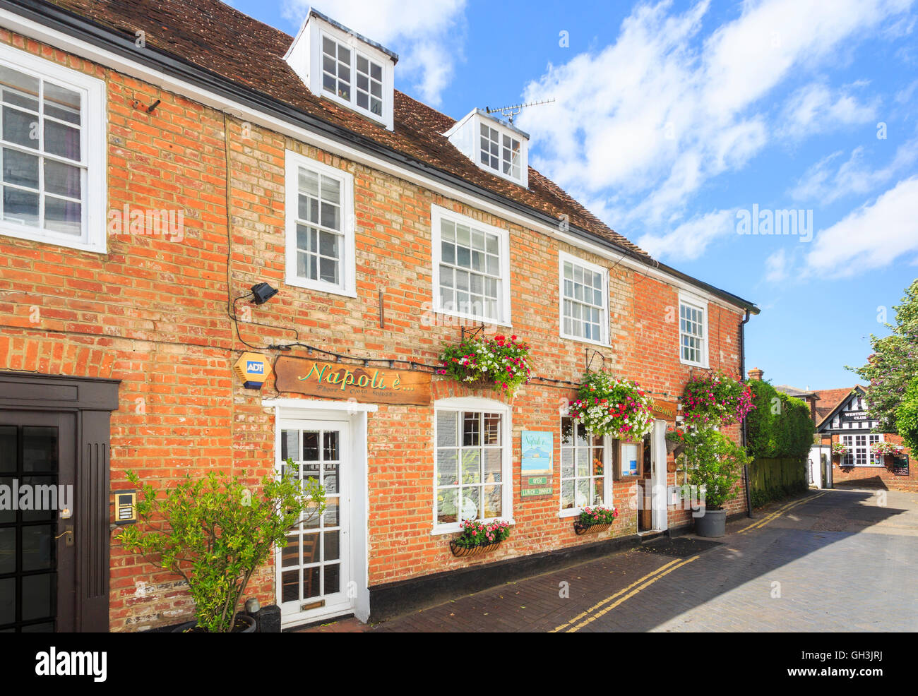 Typical red brick buildings and restaurant in Westerham, a town in the Sevenoaks District, Kent, on a sunny day - Stock Image