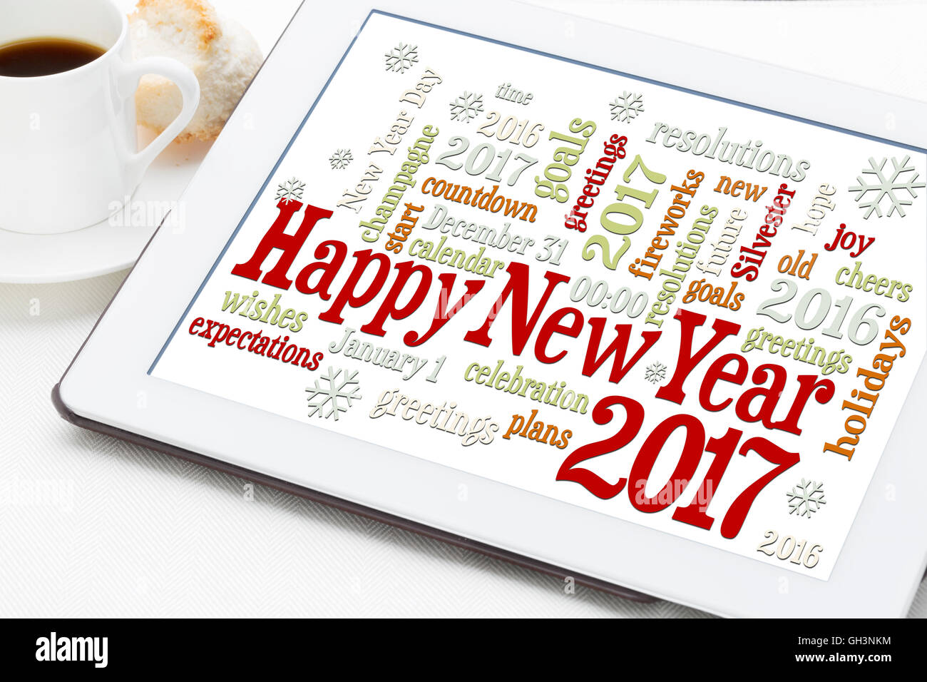 Happy New Year 2017 greetings - word cloud on a digital tablet with ...