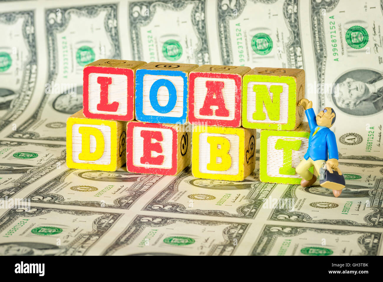 Loan Debt and money with toy man - Stock Image