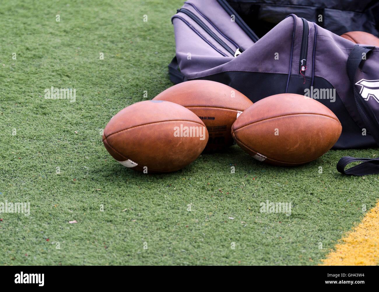 Footballs on sideline - Stock Image