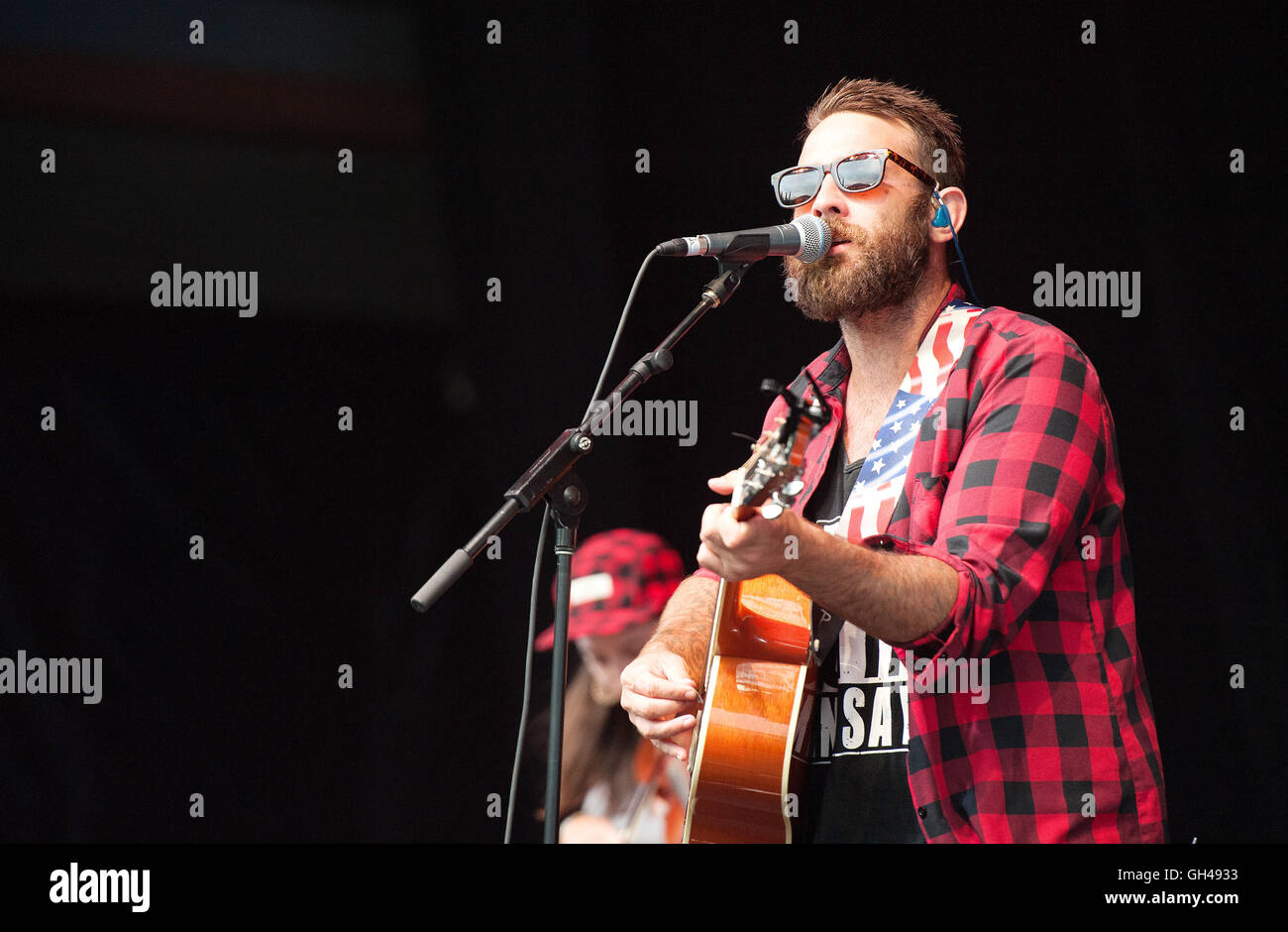 The Strumbellas in concert at the Whistler Olympic Plaza. Whistler BC, Canada.  Free outdoor rock concerts. - Stock Image