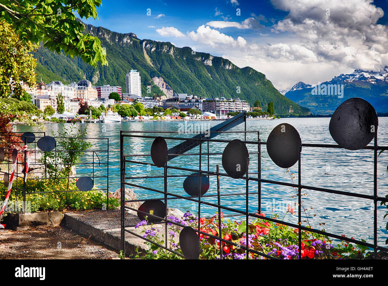 Lakeshore View of Lake Geneva at Montreux with Musical Notes Fence, Vaud Canton, Switzerland - Stock Image