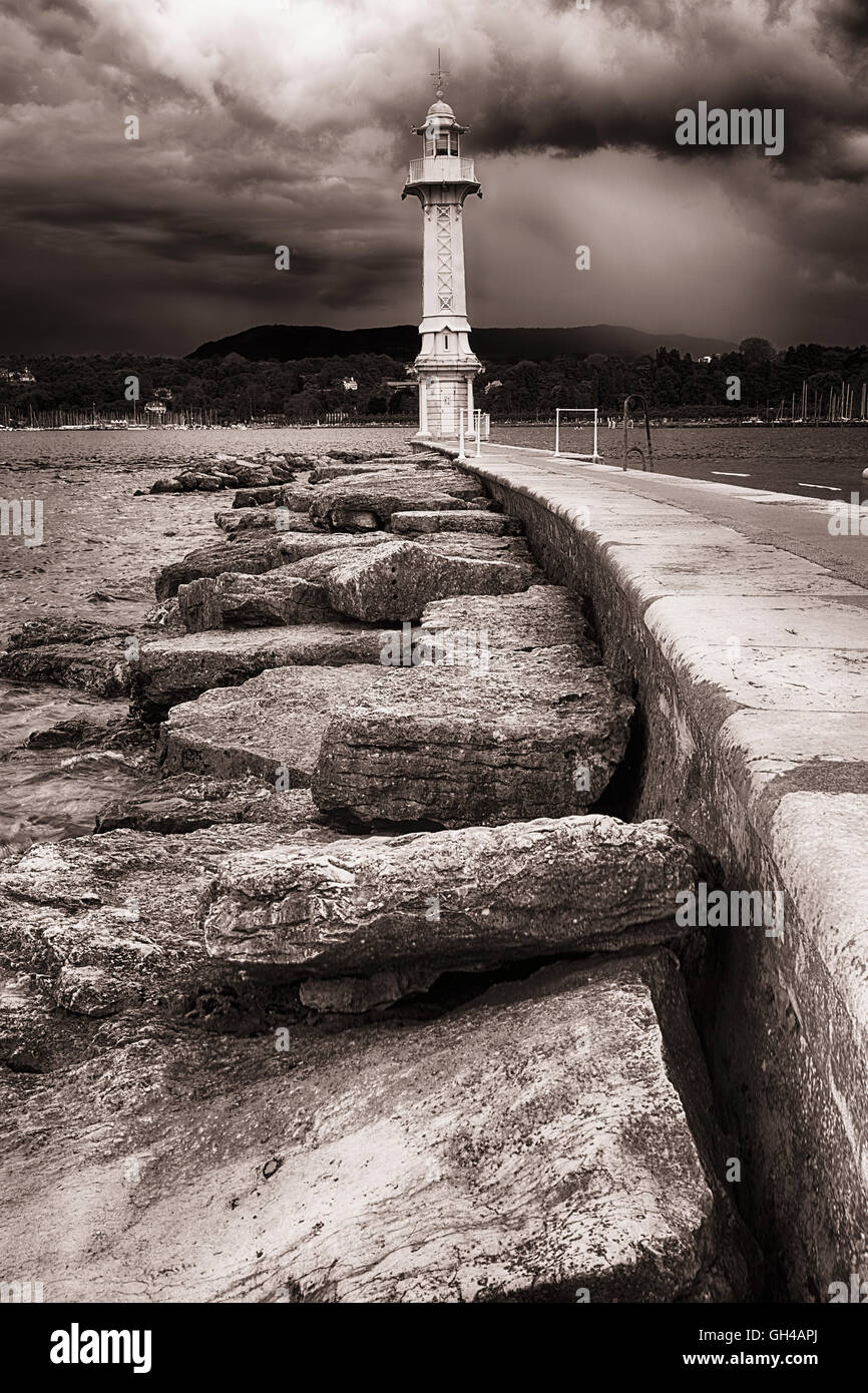 Low Angle View of a Lighthouse at the end of a Jetty, Lake Geneva, Geneva, Switzerland - Stock Image