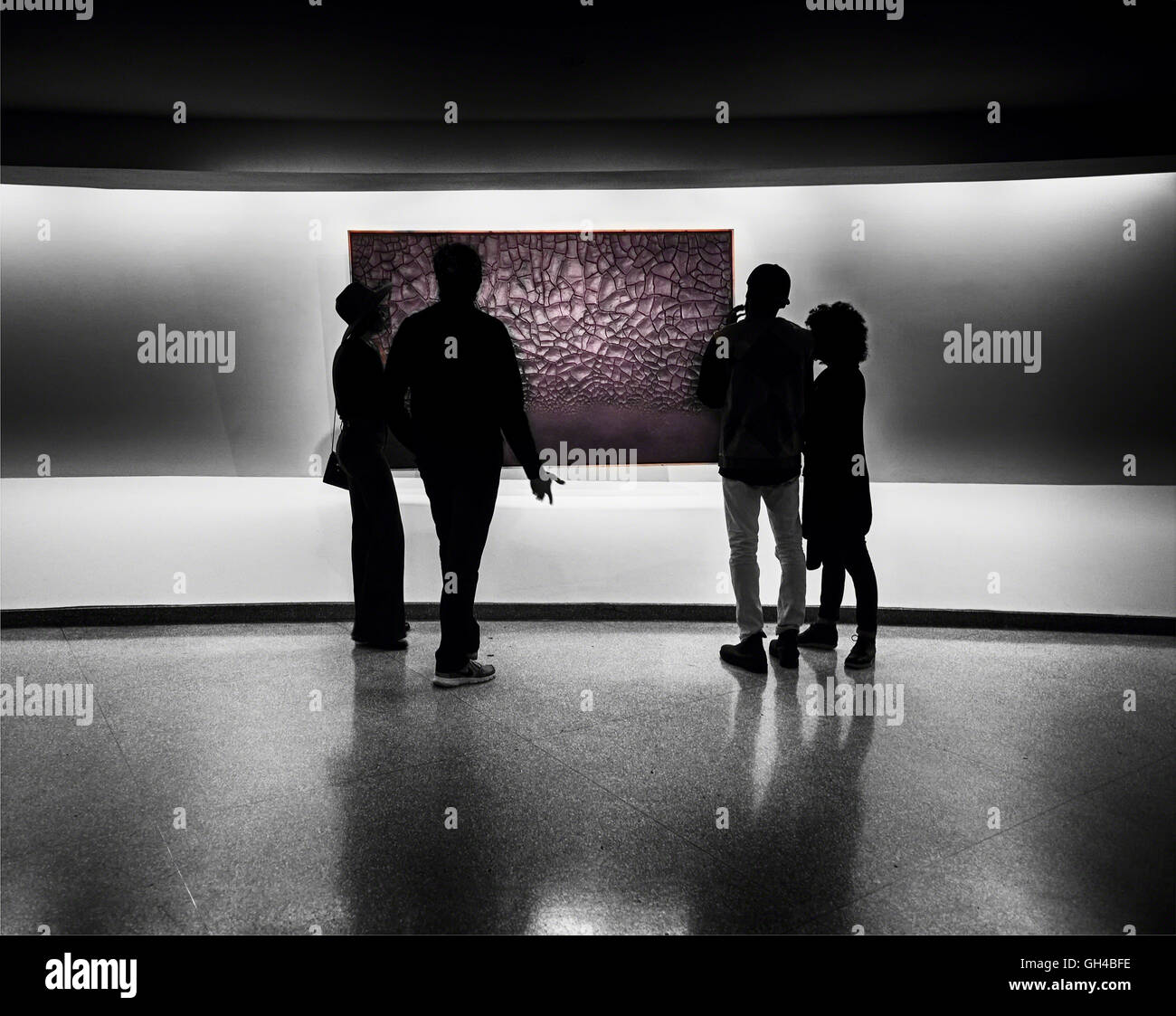 Silhouette of Two Heterosexual Couples Evaluating a Piece of Abstract Wall Art, Solomon R. Guggenheim Museum, New - Stock Image