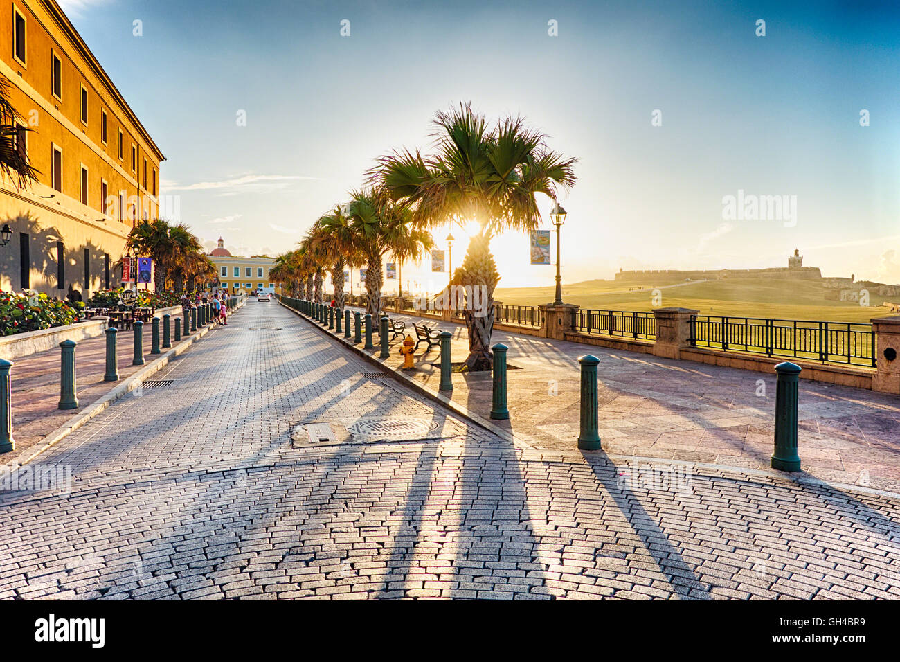 Old San Juan Sunset as Viewed From Calle Norzagaray with Fort El Morro in The Background, San Juan, Puerto Rico - Stock Image