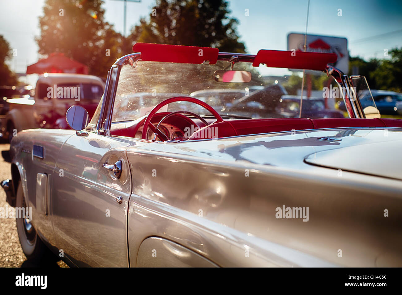 Low Angle View of a Classic American Convertible in a Drive In Parking Lot During Warm Summer Afternoon, New Jersey, - Stock Image