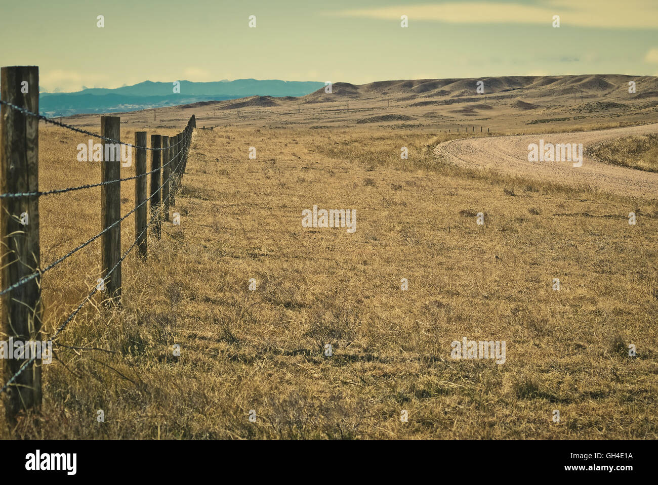 Outside drift fence to keep cattle contained on the open range in northern Colorado, USA. Retro instagram look. - Stock Image