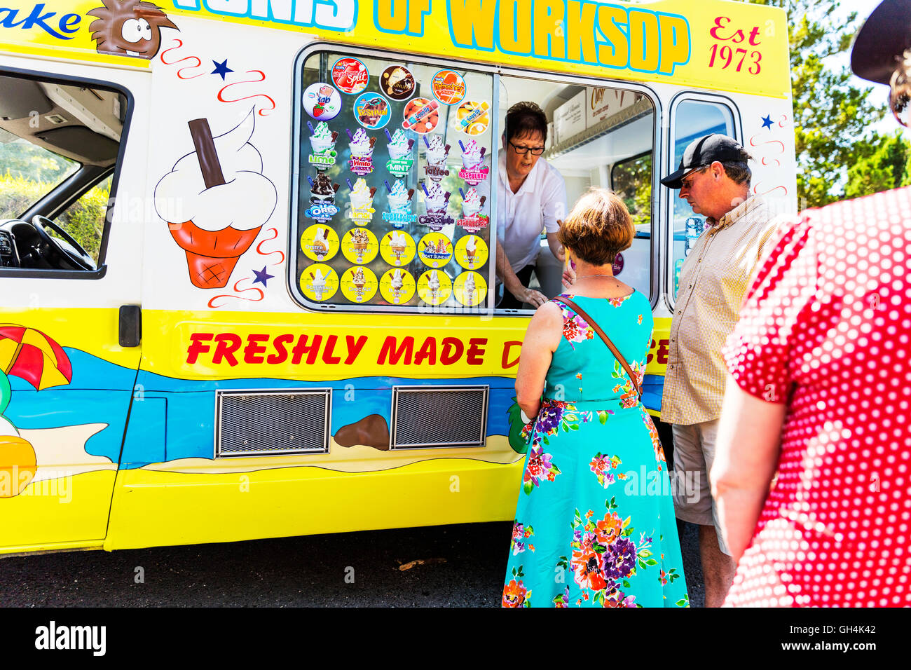 queue at ice cream van waiting for ice creams queuing serving ices lolly's in summer heat UK England GB - Stock Image
