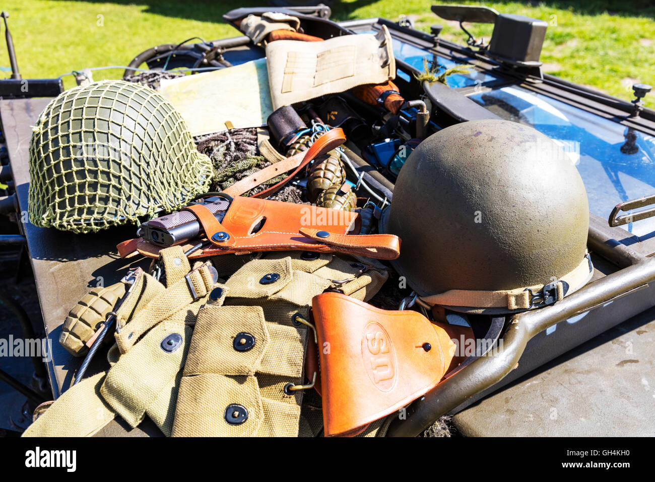 US military attire uniform hats belts weapons WW2 war wartime gear dress style vintage grenade USA American America - Stock Image