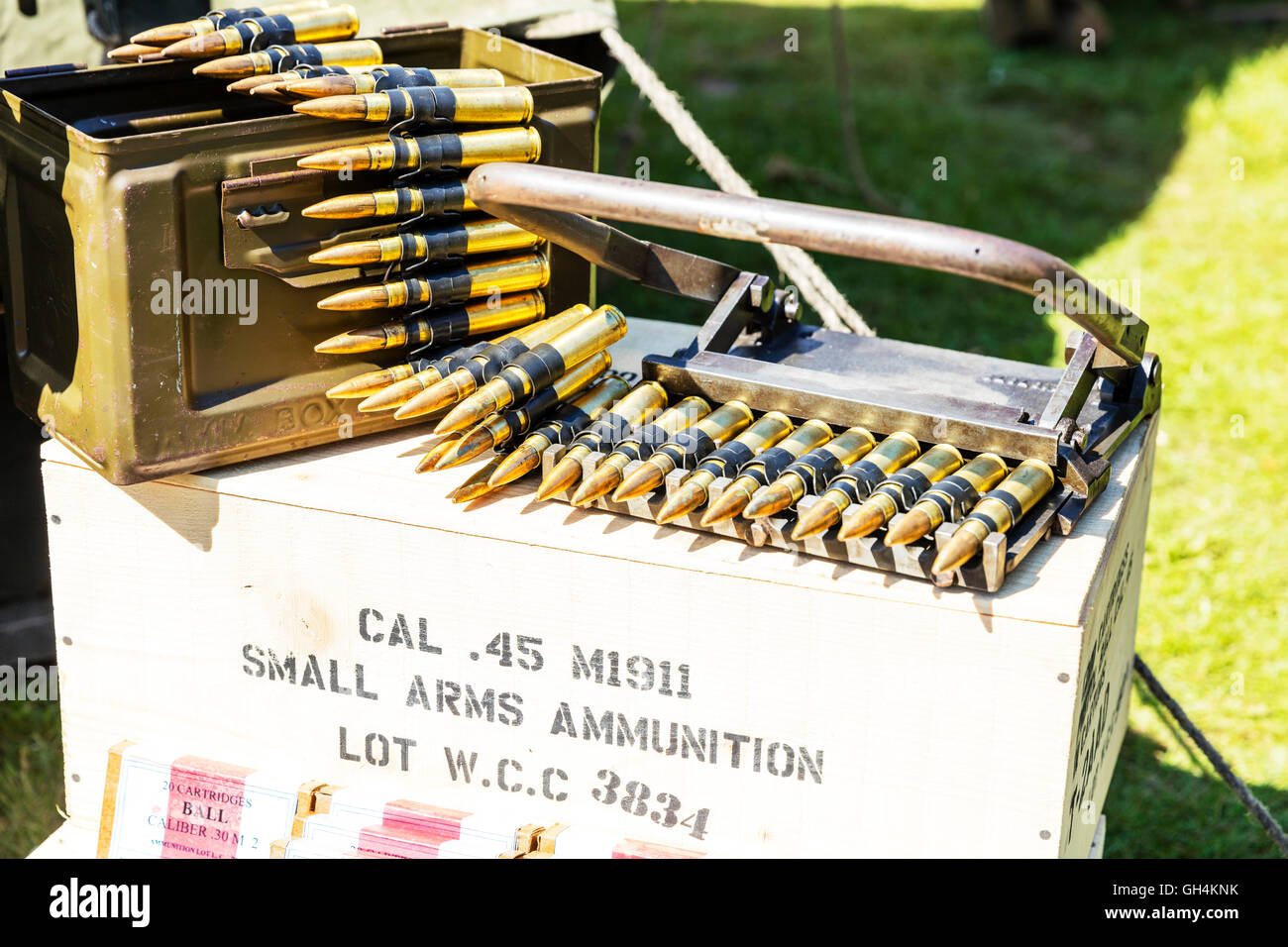 Bullets ammunition .45 cal caliber rounds small arms ammunition boxes for war killing people devastation of lives - Stock Image