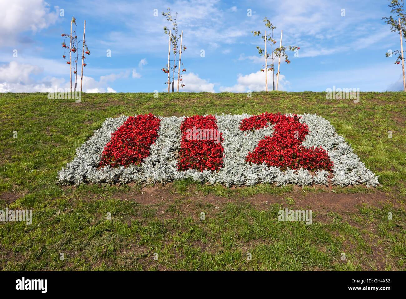 112 emergency number in flowers - Stock Image