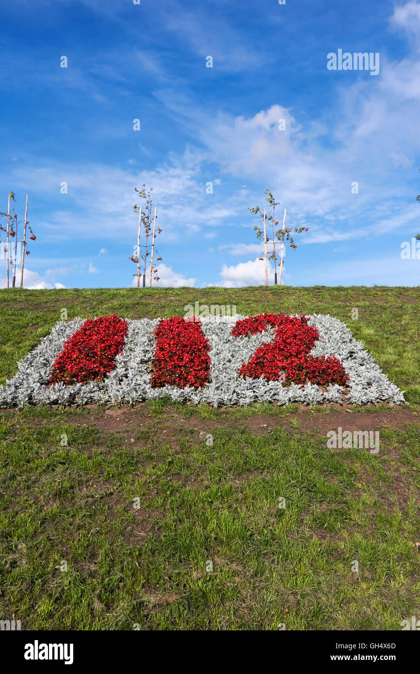 112 emergency number in flowers - Stock Image