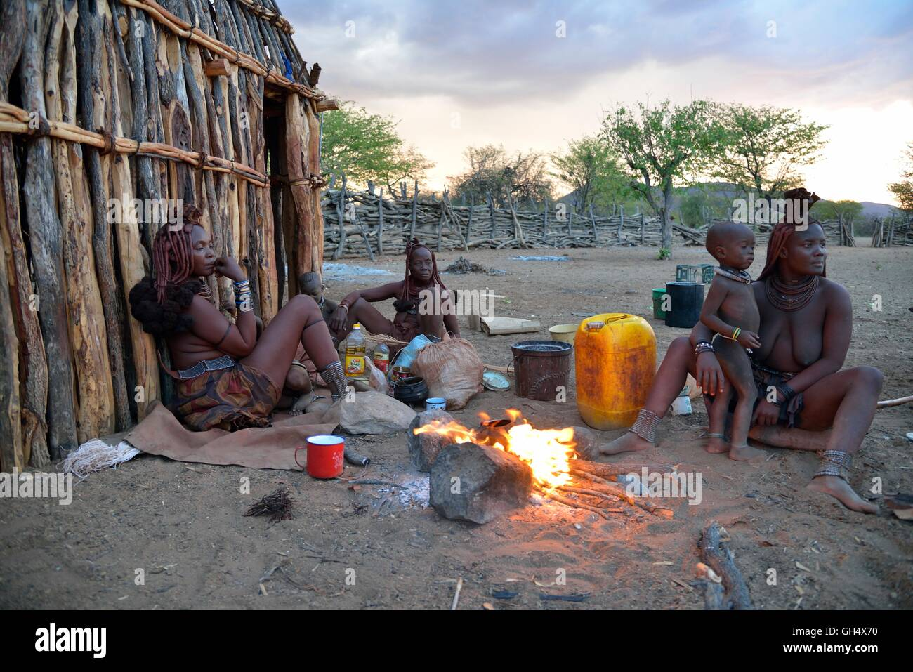 geography / travel, Namibia, Himba women at fire in her kraal in the village Omuramba, Kaokoveld, Africa, Additional - Stock Image