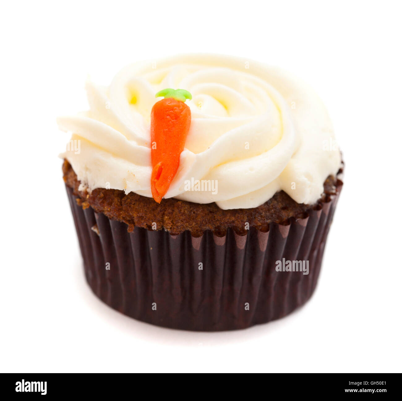 carrot cupcake with butter and sugar icing isolated on white - Stock Image