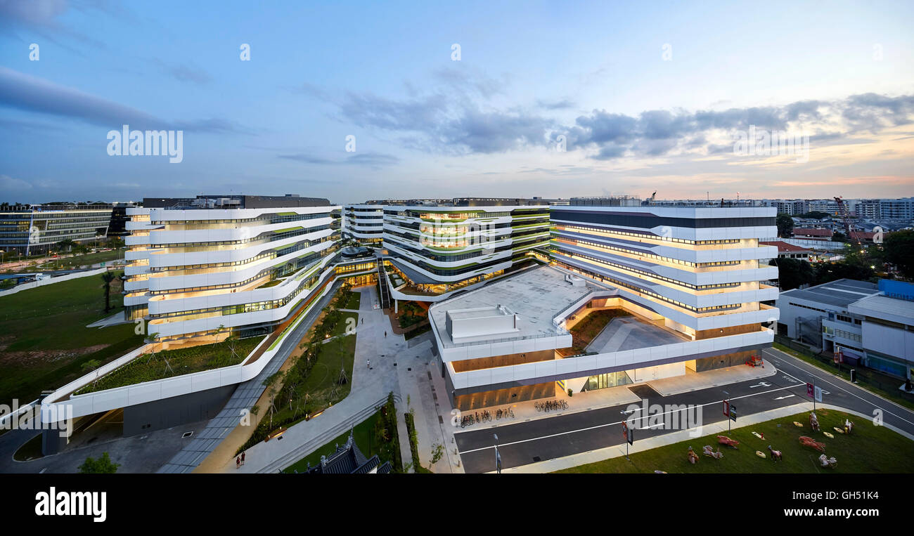 Elevated sight of entire campus with interconnected building structures at dusk. Singapore University of Technology - Stock Image