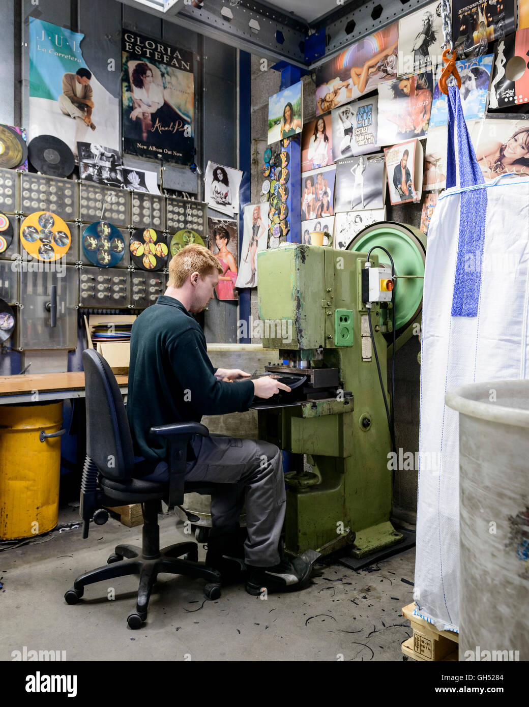 Punching the labels out of rejects so that the vinyl can be recycled. Record Industry Vinyl Factory, Haarlem, Netherlands. Stock Photo