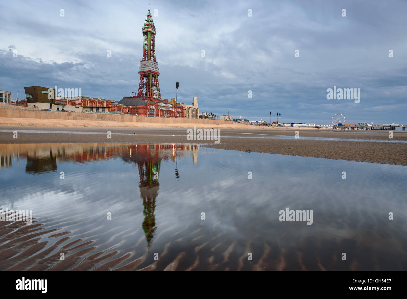 Reflection of Blackpool tower in the pond of water on the beach. - Stock Image