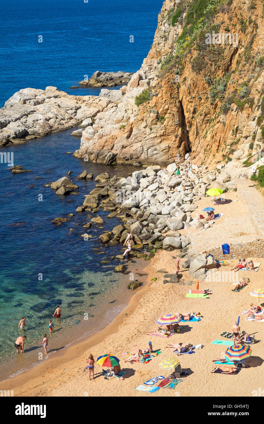 a small secluded beach at Tossa de Mar, Spain. - Stock Image