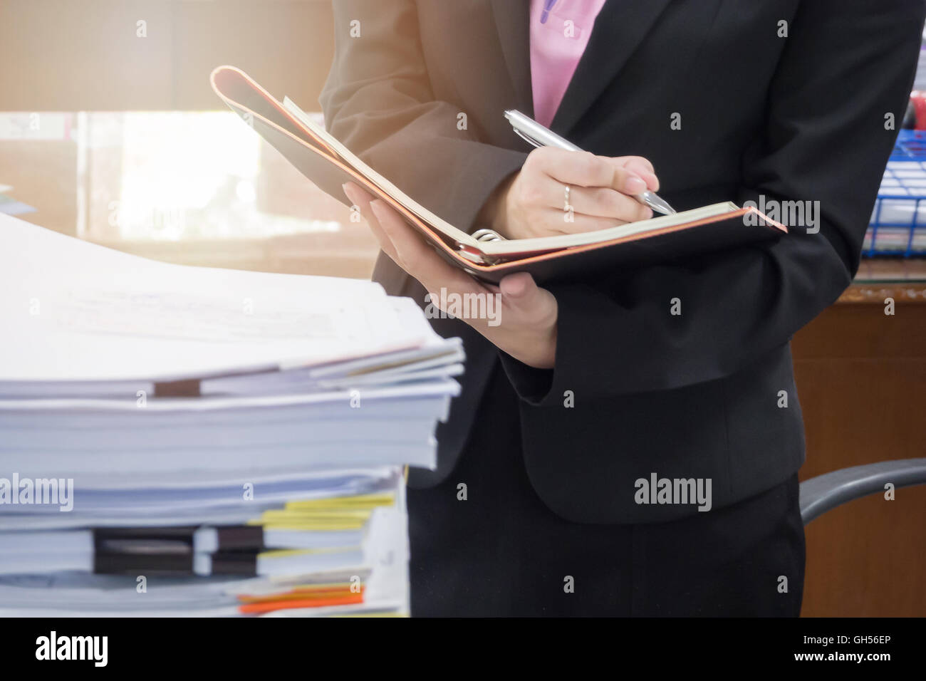 Businesswoman discussing ideas after meeting - Stock Image