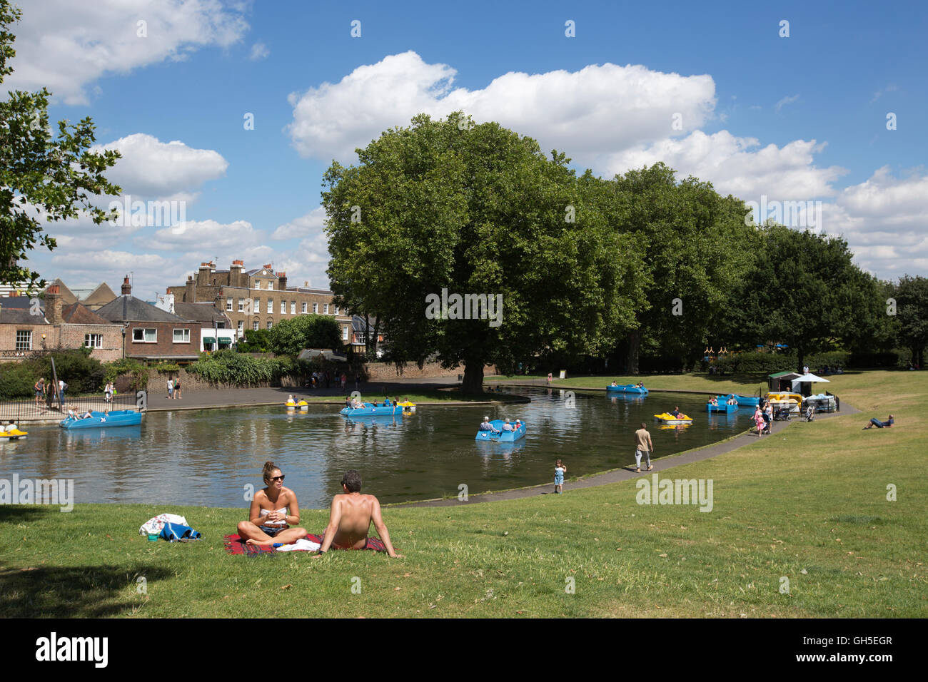 People enjoying the summer warm weather in Greenwich Park, south-east London, England, UK - Stock Image