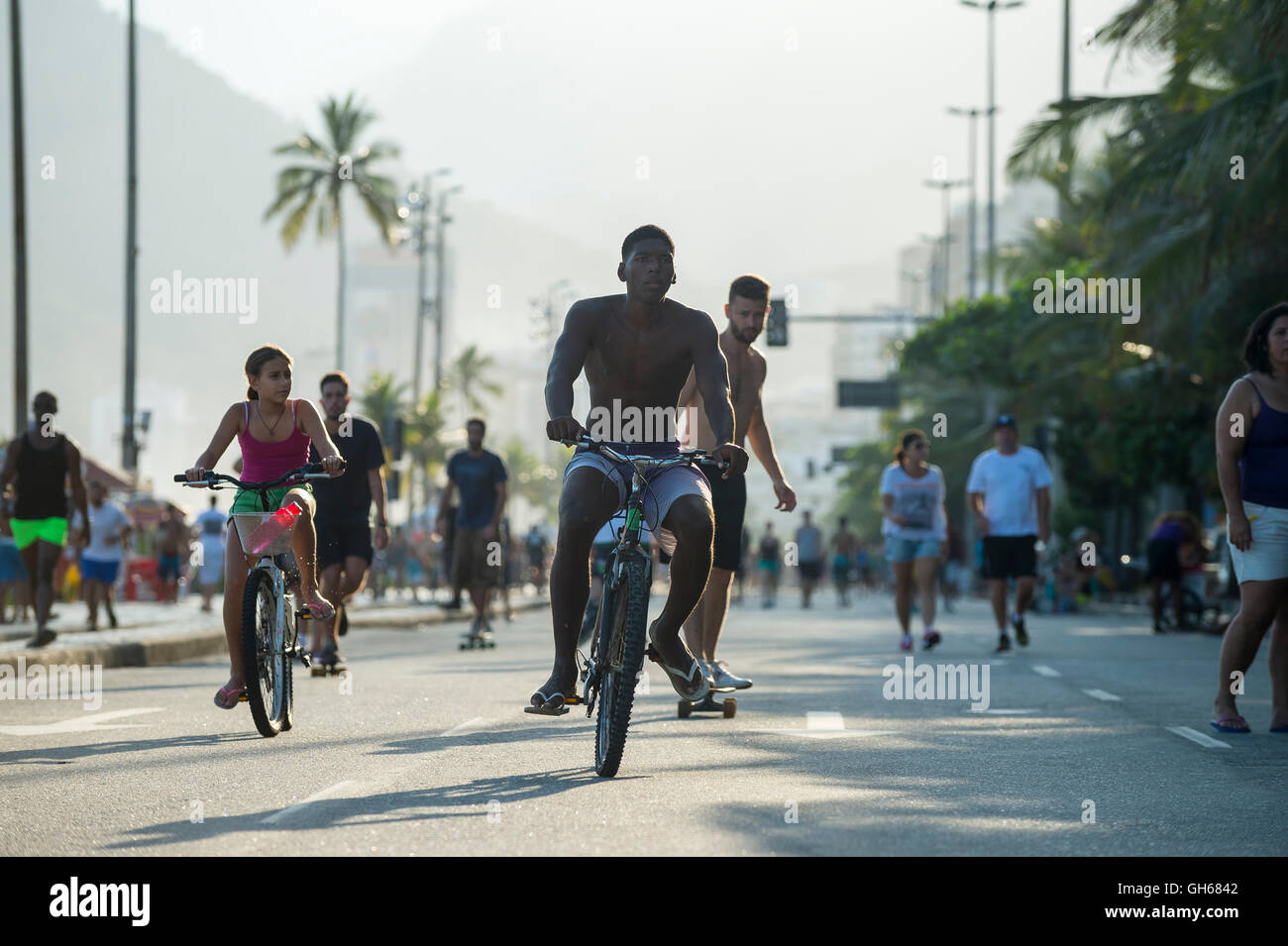 RIO DE JANEIRO - MARCH 6, 2016: Pedestrians, cyclists, joggers, and skaters take advantage of a car-free Sunday - Stock Image